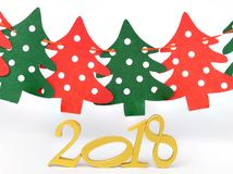 a golden number 2018 and a row of pine trees Stock Photos