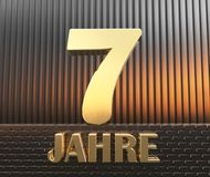 Golden number seven number 7 and the word. `years` against the background of metal rectangular parallelepipeds in the rays of sunset.  Translated from the Royalty Free Stock Photography