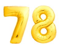 Golden number 78 seventy eight made of inflatable balloon. Isolated on white background Royalty Free Stock Photos