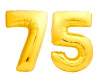 Golden number 75 seventy five made of inflatable balloon. Isolated on white background Royalty Free Stock Images