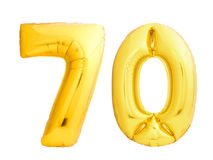 Golden number 70 seventy made of inflatable balloon. Isolated on white background Stock Photos