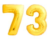 Golden number 73 seventy three made of inflatable balloon. Isolated on white background Stock Photography