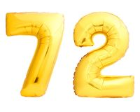Golden number 72 seventy two made of inflatable balloon. Isolated on white background Stock Photo