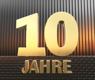 Golden number ten number 10 and the word. `years` against the background of metal rectangular parallelepipeds in the rays of sunset. Translated from the German royalty free illustration
