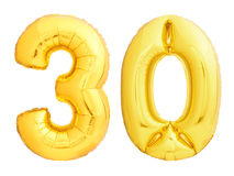 Golden number 30 thirty made of inflatable balloon. Isolated on white background royalty free stock photo