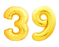 Golden number 39 thirty nine made of inflatable balloon. Golden number 39 thirty nine of inflatable balloon isolated on white background Royalty Free Stock Image
