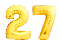 Golden number 27 twenty seven made of inflatable balloon. Isolated on white background Royalty Free Stock Photo