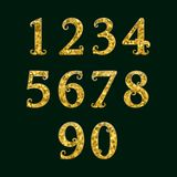 Golden numbers encrusted small glittering fragments. Vector symbols.  Royalty Free Stock Image