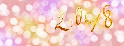 2018 golden numbers, holiday colorful background with blurred lights Stock Photo