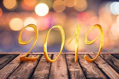 2019, golden numbers on wood table with blurred lights gold bokeh background. 2019, golden numbers on wood table with blurred lights gold bokeh abstract royalty free stock photos