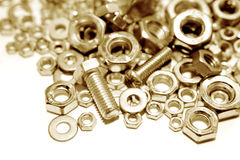 Golden Nuts & Bolts Royalty Free Stock Photo