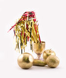 Golden objects - apple, banana, oranges, glass, party whistles Stock Photos