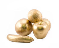 Golden objects - apple, banana and three oranges Royalty Free Stock Image