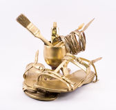 Golden objects - shoes, glass, brush, spatula, rings Royalty Free Stock Photos
