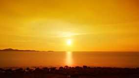 Golden ocean sunset. Gorgeous golden sunset over the ocean. Shot near Bali Hai lighthouse, Pattaya, Thailand. Timelapse FullHD 1080p stock footage