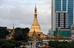 Golden octagon of Sula pagoda located in the heart of downtown Yangon, making it more than 2,600 years old. Yangon, Myanmar June 6, 2018: Golden octagon of Sula Stock Photography
