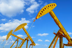 Golden Oil pump of crude oilwell rig Royalty Free Stock Images