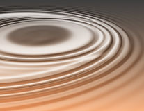 Golden oily liquid ripples Stock Photos