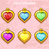 Golden old amulets hearts with gems Stock Photo