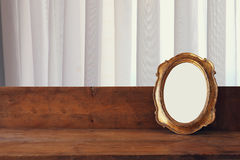 Golden old blank frame on wooden window sill Royalty Free Stock Photos