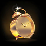 Golden old fashioned  alarm clock on black  background. Royalty Free Stock Photo