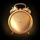 Golden old fashioned  alarm clock on black  background. Royalty Free Stock Images