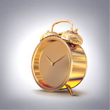 Golden old fashioned  alarm clock on grey  background. Royalty Free Stock Images