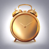 Golden old fashioned  alarm clock on grey  background. Royalty Free Stock Photography