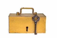 The golden old trunk with the key isolated on a white background Royalty Free Stock Images