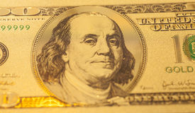 Golden one hundred dollars banknote Royalty Free Stock Image