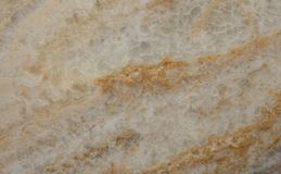 Golden Onyx close up with pores. Natural golden orange stone close up, a translucent onyx with pores and veins showing stock images