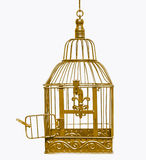 Golden open bird cage. Isolated Royalty Free Stock Photo