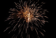 Golden orange amazing fireworks. Isolated in dark background close up stock photography