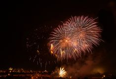 Golden orange amazing fireworks isolated in dark background close up with the place for text, , Malta Stock Images