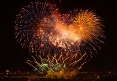 Golden orange amazing fireworks isolated in dark background close up with the place for text, Malta fireworks festival, 4 of July, Stock Photography