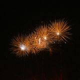 Golden orange amazing fireworks isolated in dark background close up with the place for text, Malta fireworks festival, 4 of July Stock Photos