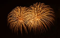 Golden orange amazing fireworks isolated in dark background close up with the place for text, Malta fireworks festival, 4 of July, Royalty Free Stock Photos