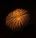 Golden orange amazing fireworks isolated in dark background close up with the place for text, Malta fireworks festival, 4 of July, Royalty Free Stock Images