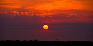 Golden Orange coastal sunrise cloudscape. stock photo