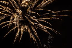 Golden orange fireworks on dark background Royalty Free Stock Images