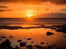 Golden orange light of the setting sun off the coast of Tenerife, Spain. royalty free stock photos