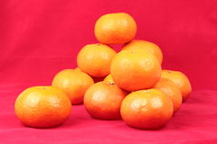 Golden orange on red background, to celebrate for Chinese festiv Royalty Free Stock Image