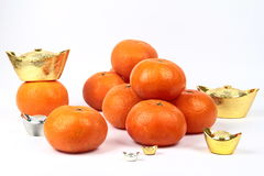 Golden orange with silver and gold of silver ingots . Royalty Free Stock Photography