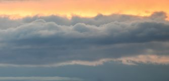 Golden orange sky with clouds stock photos