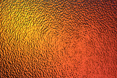 Golden Orange and Yellow Glass Background - Abstract Art and Color. Textured Golden, Orange and Yellow Glass photographed as an Abstract Art piece and background Royalty Free Stock Image