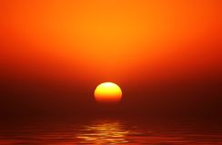 Golden Orb Sunset. The sun was a golden orb through haze on the horizon royalty free stock photography