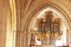Golden orgue from catholic church from Romania. Musical instrument from trinity roman catholic church from Cluj Napoca Romania Stock Photo