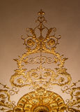 Golden ornament on the ceiling Stock Photos