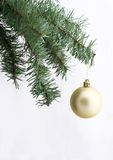 Golden ornament on christmas tree. With free space for writing stock photos