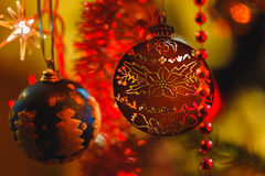 Golden ornament in Christmas tree surrounded by colorful lights Royalty Free Stock Image